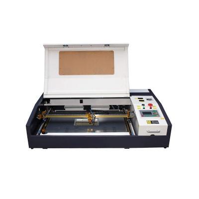 TEN-HIGH Máquina de corte por grabado láser Cortadora láser de 40 W 4060 400 x 600 mm 15.7 x 23.6 pulgadas con un escritorio pequeño